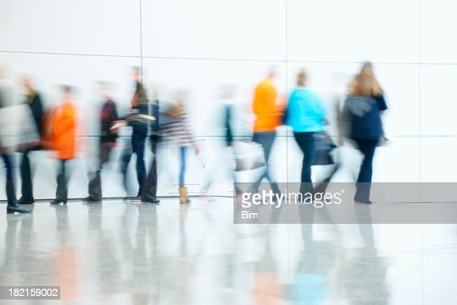 'Group of People Walking, Blurred Motion'