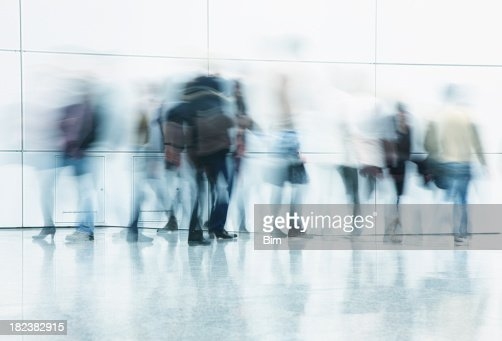 'Commuters walking in corridor, blurred motion'