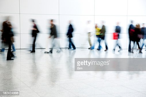 Commuters Walking in Corridor, Blurred Motion