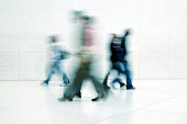 'People Walking in White Hall, High Key, Blurred Motion'