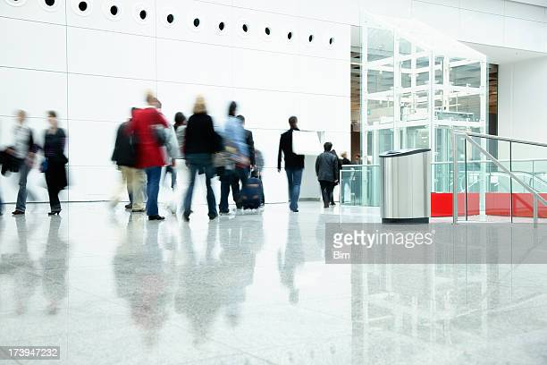 Commuters Walking in Modern Corridor, Blurred Motion