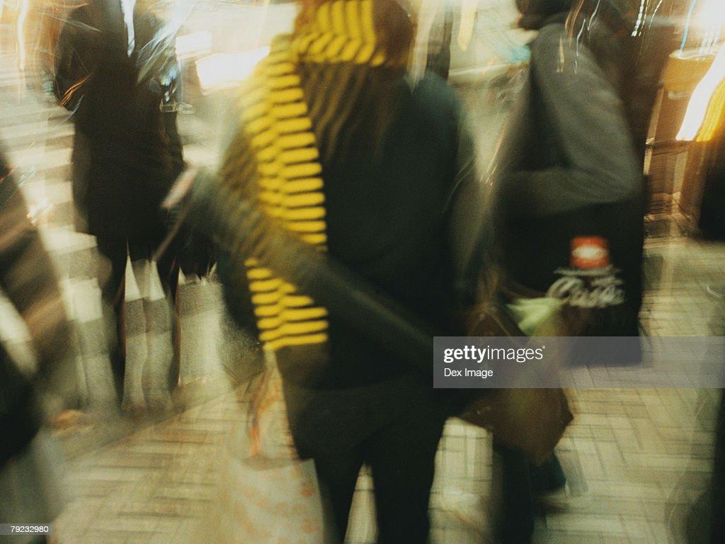 Commuters walking in subway passageway (blurred motion) : Stock Photo