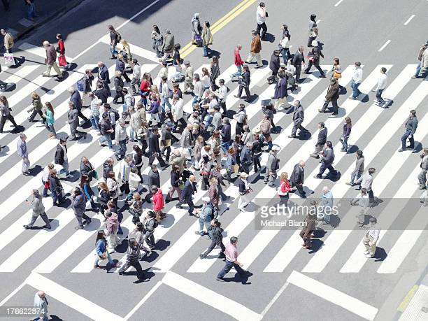 commuters walking on zebra crossing