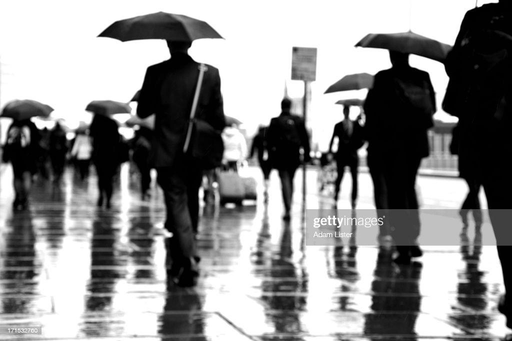 Commuting in the rain : Stock Photo