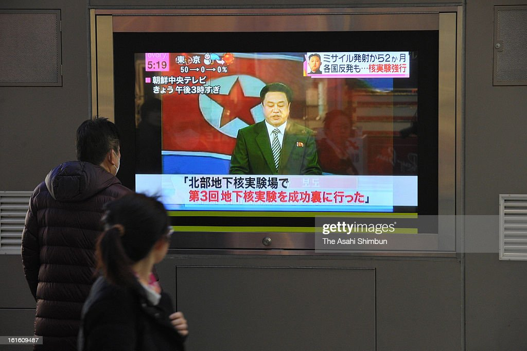 Commutors watch a televsion broadcasting reporting the North Korea's nuclear test at an electronics store on February 12, 2013 in Tokyo, Japan. North Korea confirmed it had successfully carried out an underground nuclear test as a shallow earthquake with a magnitude of 4.9 was detected by several international monitoring agencies. South Korea and Japan both assembled an emergency meeting of their respective national security teams after the incident.