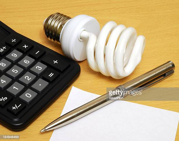 Compact Fluorescent Lightbulb, calculator and pen