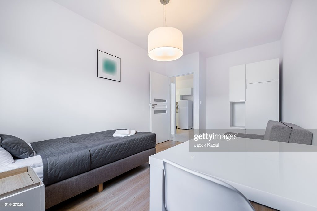 Compact white sleeping room interior design stock photo for Sleeping room interior design
