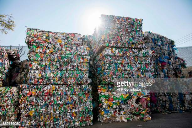 Compacted blocks of aluminum cans are seen at a waste management plant in Geri on the outskirts of the Cypriot capital Nicosia on October 5 2017 /...