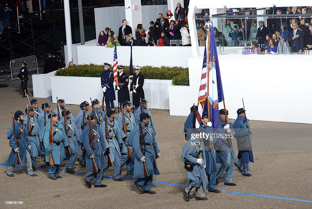 Company A of the Civil War-era 54th Massachusetts Volunteer Infantry Regiment march past U.S. President Barack Obama during the Inauguration Parade for his second term in Washington, D.C., Monday, January 21, 2013.