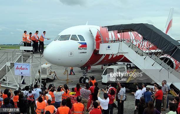 Company and airport officials pour champagne on newly arrived AirAsia's Airbus A320 passenger aircraft at Clark airport in Angeles City Pampanga...