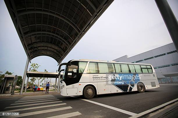 A company bus transporting workers departs the Samsung Electronics Vietnam Co Plant at Yen Phong Industrial Park in Bac Ninh Province Vietnam on...