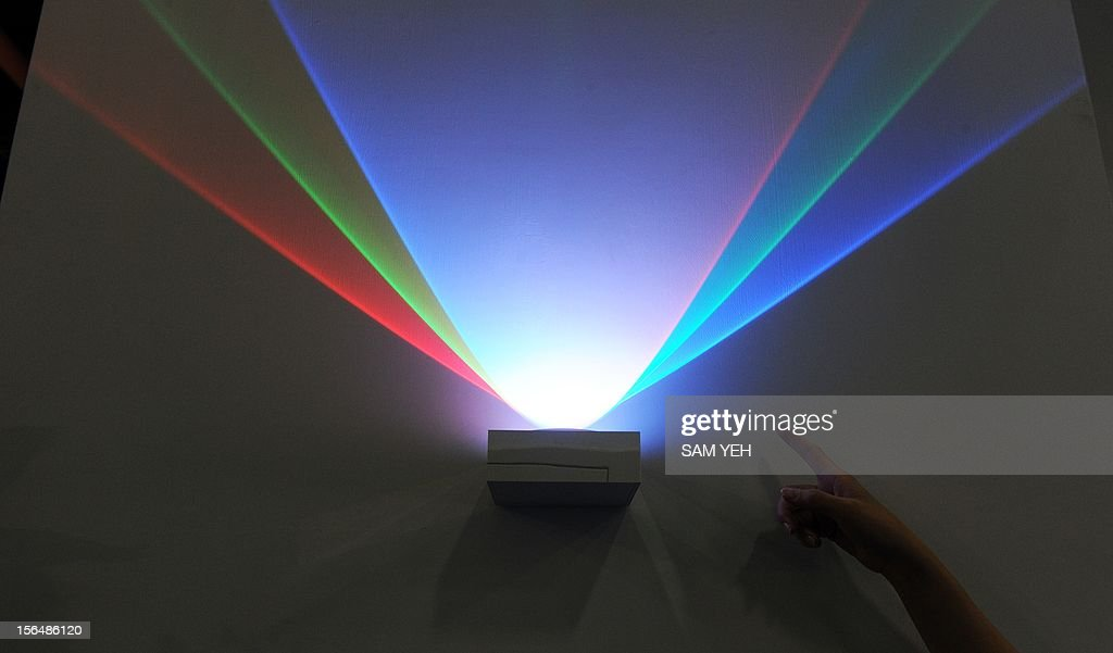 A company employee introduces a LED light during a building materials fair at the World trade Center in Taipei on November 16, 2012. More then 1,200 booths take part in this four-day show between November 16 to 19. AFP PHOTO / Sam Yeh