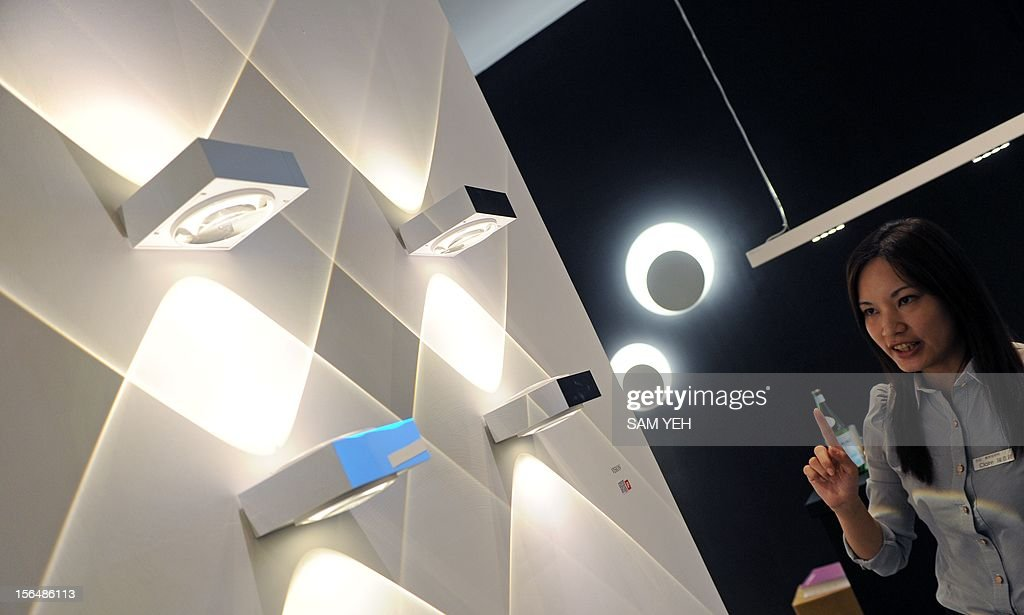 A company employee introduces LED lights during a building materials fair at the World trade Center in Taipei on November 16, 2012. More then 1,200 booths take part in this four-day show between November 16 to 19. AFP PHOTO / Sam Yeh