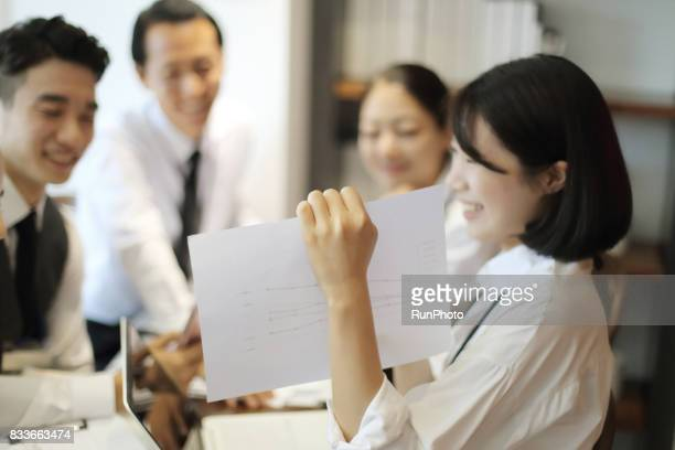 company employee who presents to a colleague of the company with charts