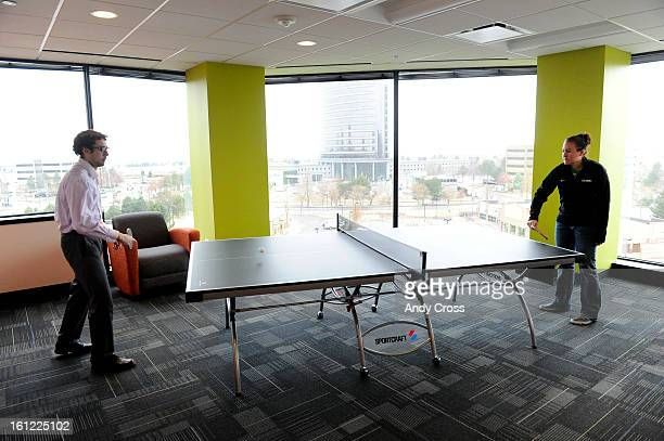 MBS DEV company employees Josh Teixeira accountant left and Melisa <cq> consultant right play a quick game of pingpong at their offices Wednesday...