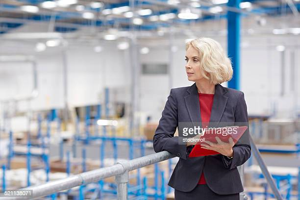 Company executive doing inspection in warehouse