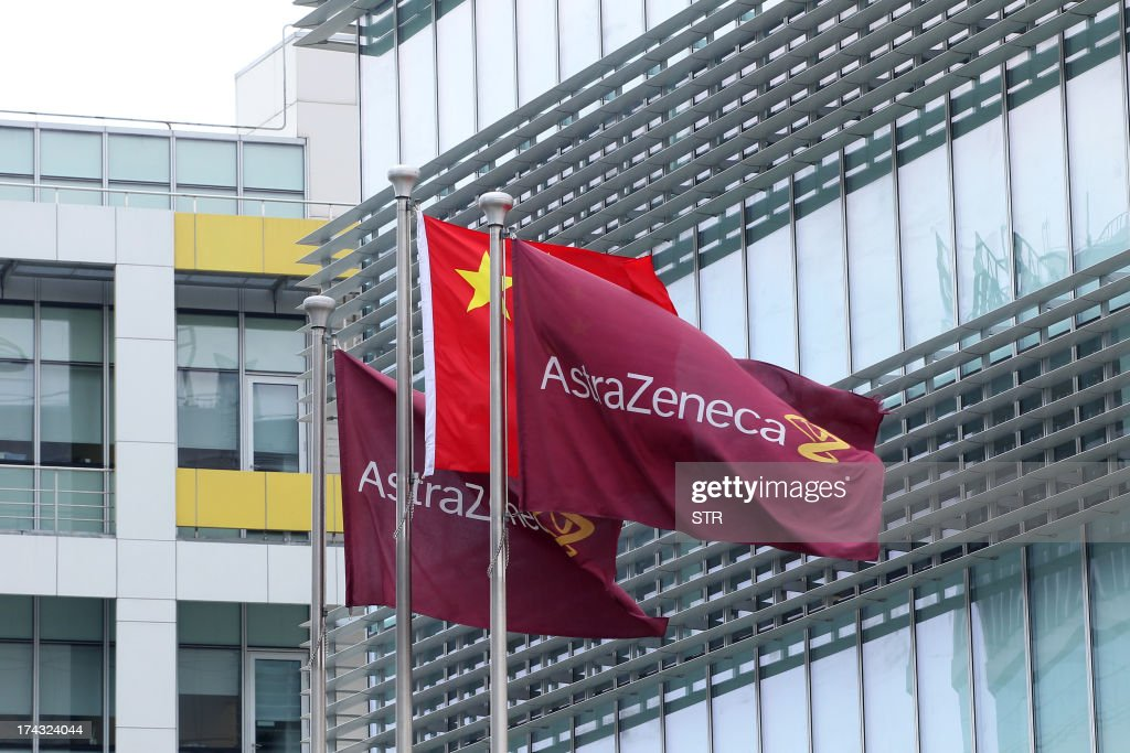 Company flags fly next to the Chinese one outside the headquarters of Britain's AstraZenica China headquarters in the Zhangjiang district of Shanghai on July 24, 2013. Beijing's targeting of British pharmaceutical giant GlaxoSmithKline (GSK) in a high-profile bribery probe is a reminder of the risks foreign companies face when seeking the huge rewards of China's market, analysts say. Police say GSK staff offered government officials and doctors bribes, and took kick-backs from travel agencies to organise conferences, some of which were fake. Chinese authorities have also questioned three Shanghai-based employees of Britain's AstraZeneca, detaining two, and have visited the offices of Belgium's UCB, according to the companies, although they did not specify what was being investigated. CHINA