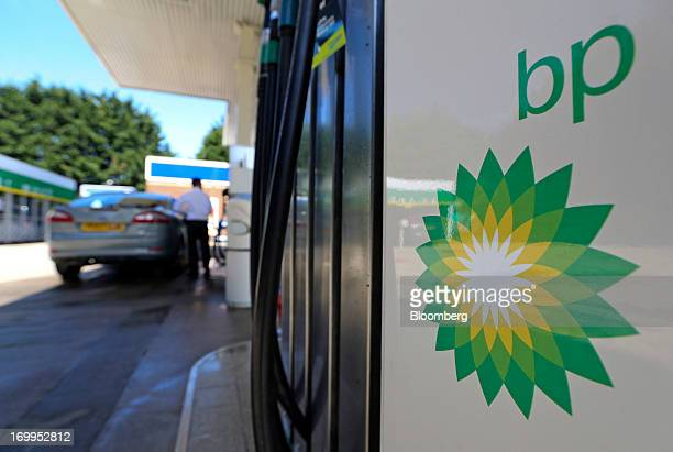 A BP company logo is displayed on a fuel pump on the forecourt of a gas station operated by BP Plc in London UK on Tuesday June 4 2013 Royal Dutch...