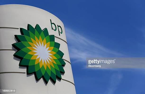 A BP company logo is displayed on the forecourt of a gas station operated by BP Plc in London UK on Tuesday June 4 2013 Royal Dutch Shell Plc BP Plc...
