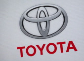 A company logo is seen during the unveiling of the new 2015 Camry during a media preview of the 2014 New York International Auto Show April 16 2014...