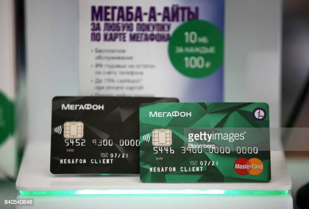 A company logo sits on a promotional Mastercard Inc bank card inside a MegaFon PJSC mobile phone store in Moscow Russia on Tuesday Aug 29 2017...
