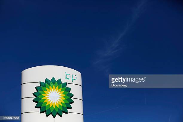A BP company logo sits on display on the forecourt of a gas station operated by BP Plc in London UK on Tuesday June 4 2013 Royal Dutch Shell Plc BP...