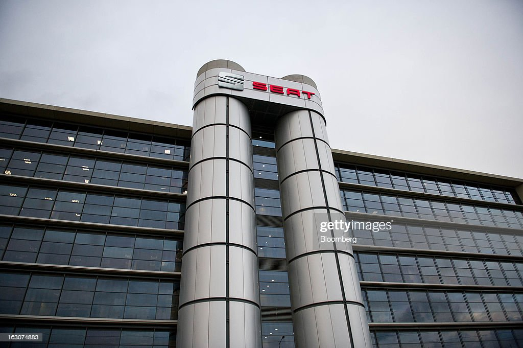 A company logo sits on display outside offices at the headquarters of Seat SA in Martorell, Spain, on Thursday Feb. 28, 2013. Seat will invest 300 million euros a year in the next five years and renew its range of models, Efe said, citing an interview with James Muir, head of the Spanish unit of Volkswagen AG. Photographer: David Ramos/Bloomberg via Getty Images
