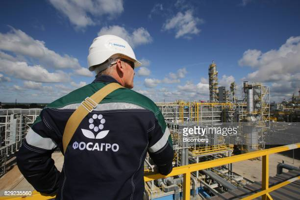 A company logo sits on the back of a branded jacket worn by a visitor overlooking the new ammonia production unit currently under testing at the...
