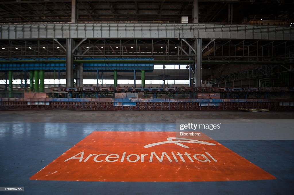 A company logo sits on the empty floor of the cooling shop at the ArcelorMittal Poland SA steel mill in Krakow, Poland, on Tuesday, Aug. 6, 2013. ArcelorMittal, the biggest steelmaker globally and in Poland, said on March 15 it expects European demand to slide before rebounding in 2014. Photographer: Will Boase/Bloomberg via Getty Images