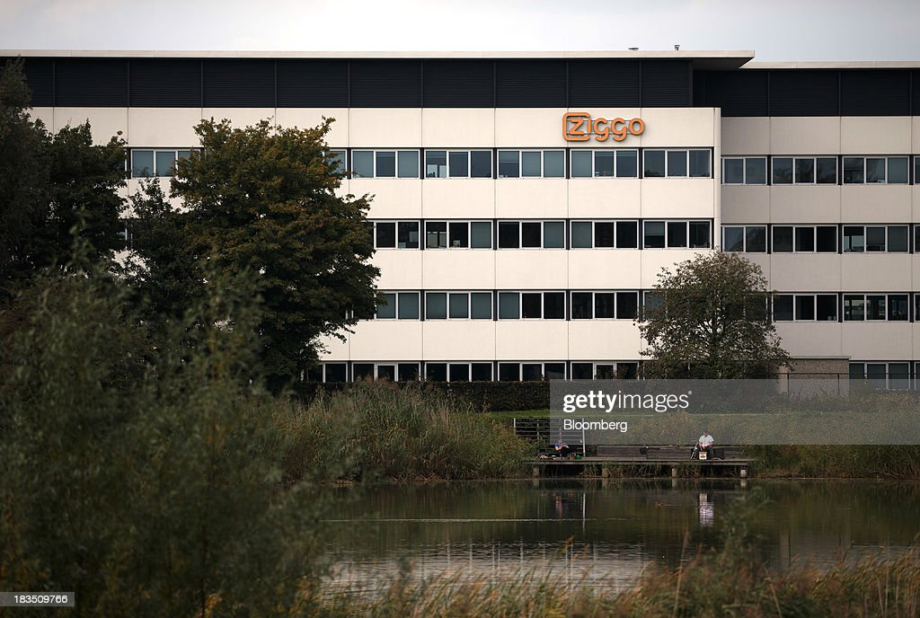 A company logo sits on the headquarters of Ziggo NV in Utrecht, Netherlands, on Sunday, Oct. 7, 2013. Cable-TV provider Ziggo, which is 28.5 percent owned by Liberty Global Plc, is pushing into the Dutch mobile market with low-priced packages, following a playbook pioneered by French discount operator Iliad SA. Photographer: Jasper Juinen/Bloomberg via Getty Images