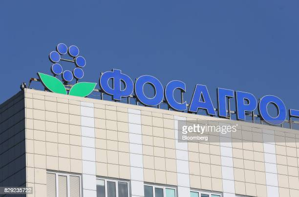 A company logo stands on an office building at the PhosAgroCherepovets fertilizer plant operated by PhosAgro PJSC in Cherepovets Russia on Wednesday...