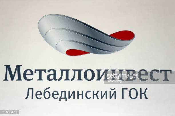 A company logo stands on the wall at the Lebedinsky GOK iron ore mining and processing plant operated by Metalloinvest Holding Co in Gubkin Russia...