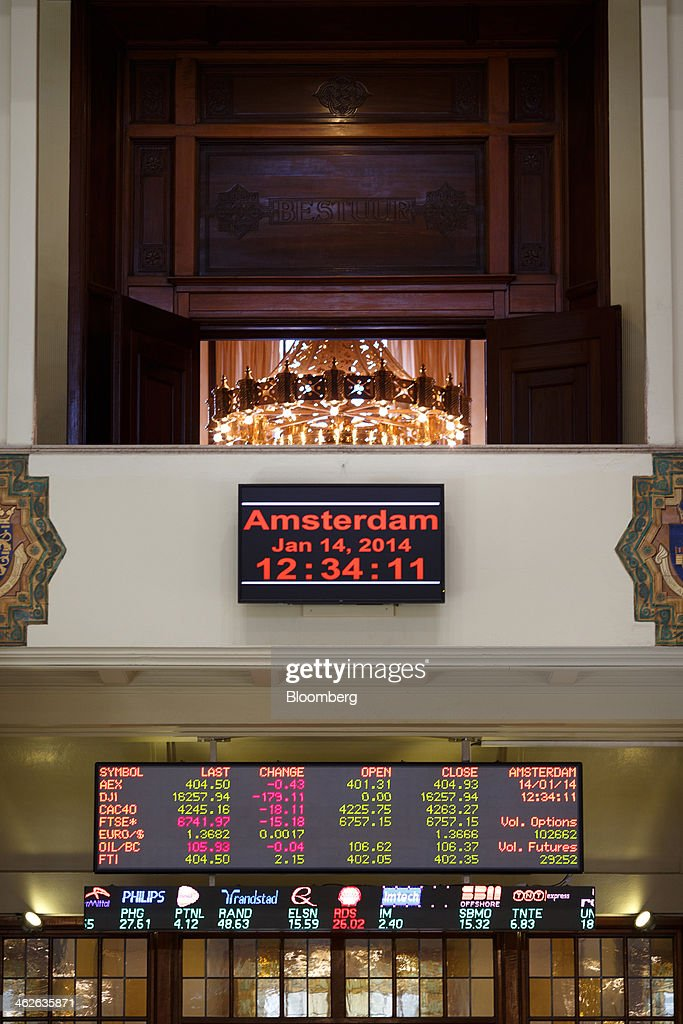 Company logos and stock prices are displayed on an electronic board inside the Amsterdam Stock Exchange, operated by Euronext NV, a unit of IntercontinentalExchange Group Inc. (ICE), in Amsterdam, Netherlands, on Tuesday, Jan. 14, 2014. ICE plans to sell as much as 30 percent of Euronext NV before the operator of the Paris and Amsterdam exchanges goes public this year, three people with knowledge of the matter said. Photographer: Jasper Juinen/Bloomberg via Getty Images