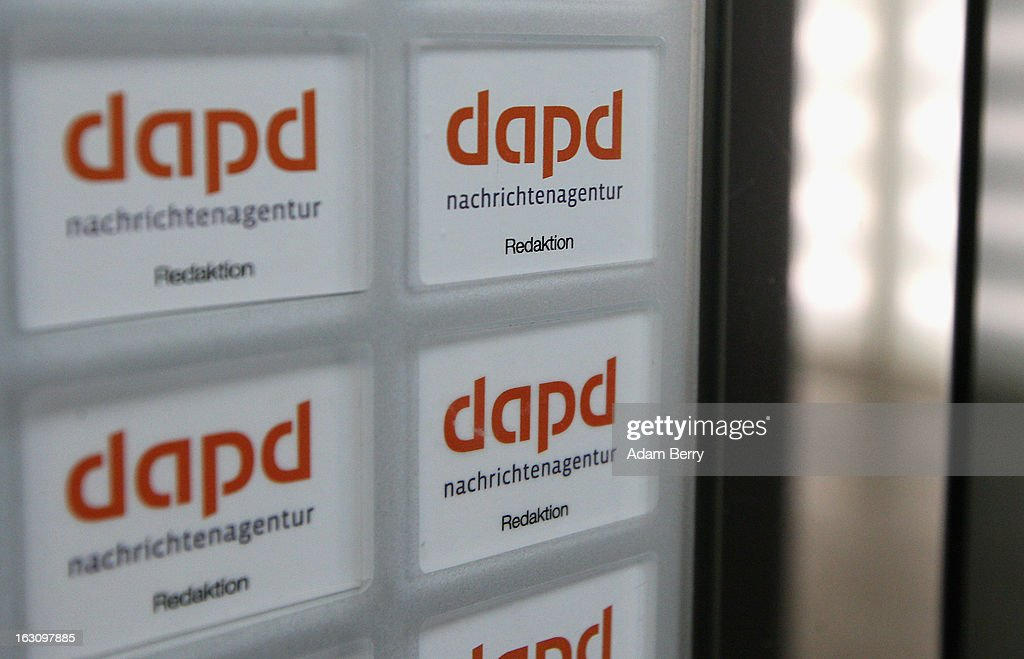 Company logos are seen in the elevators of the offices of the German news agency dapd on March 4, 2013 in Berlin, Germany. The country's second-largest news agency, dapd, was forced to declare insolvency for the second time in five months on March 1.