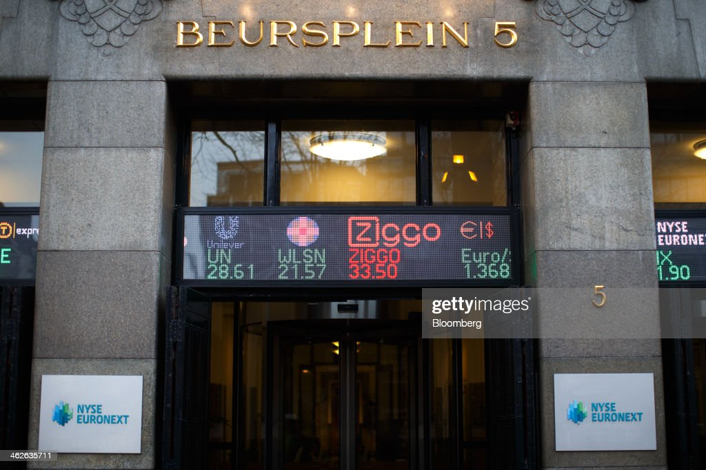 Company logos, including Unilever NV, left, and Ziggo NV, second right, currency symbols and stock prices are displayed on an electronic board outside the Amsterdam Stock Exchange, operated by Euronext NV a unit of IntercontinentalExchange Group Inc, (ICE) in Amsterdam, Netherlands, on Tuesday, Jan. 14, 2014. ICE plans to sell as much as 30 percent of Euronext NV before the operator of the Paris and Amsterdam exchanges goes public this year, three people with knowledge of the matter said. Photographer: Jasper Juinen/Bloomberg via Getty Images