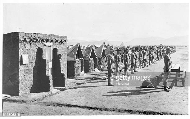 Company M 16th Infantry El Valle Mexico stands for inspection September 16 1916 Orderlyroom and bulletin board in foreground
