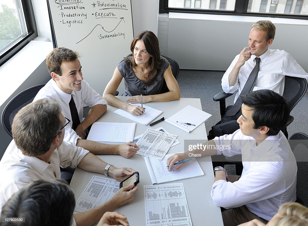 Company meeting with man texting : Stock Photo
