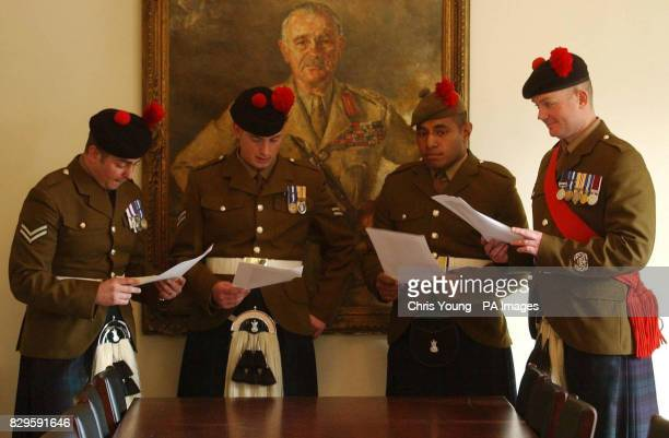 Company Sergeant Major David 'Harry' Hood smiles on as Corporal Peter Laing Lance Corporal Steven Leslie and Private Jometani Matia Lawaci read their...