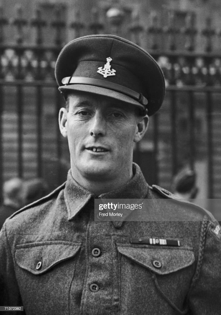 Company Sergeant Major Stanley Hollis of the Green Howards, winner of the first Victoria Cross awarded for bravery during the D-Day landings, pictured after receiving his medal at an investiture at Buckingham Palace, 10th October 1944.