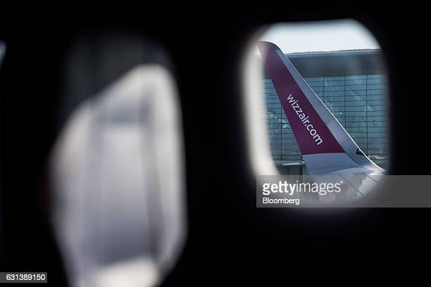 A company website sits on the wingtip of a passenger aircraft operated by Wizz Air Holdings Plc at Liszt Ferenc airport in Budapest Hungary on Monday...