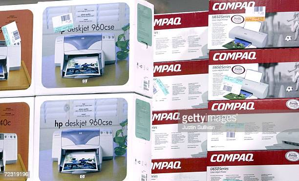Compaq and Hewlett Packard printer boxes share shelf space at a Best Buy store March 7 2002 in San Francisco CA Standard Poors cut HewlettPackard Cos...