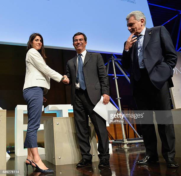 Compare candidates for mayor of Rome Virginia Raggi and Roberto Giachetti at Unindustria Rome on june 10 2016