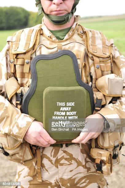 A comparison of British Army body armour At the front is the small plate of body armour that only covers the heart Behind it is the much larger plate...