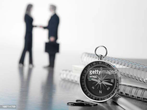 Kompass und Geschäftsmeetings