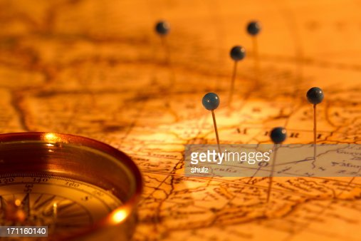 Compass and pins on a map