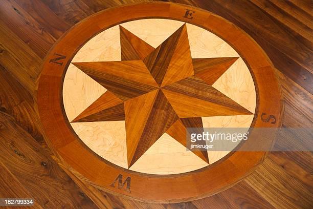 Compass inlay in a hardwood floor.
