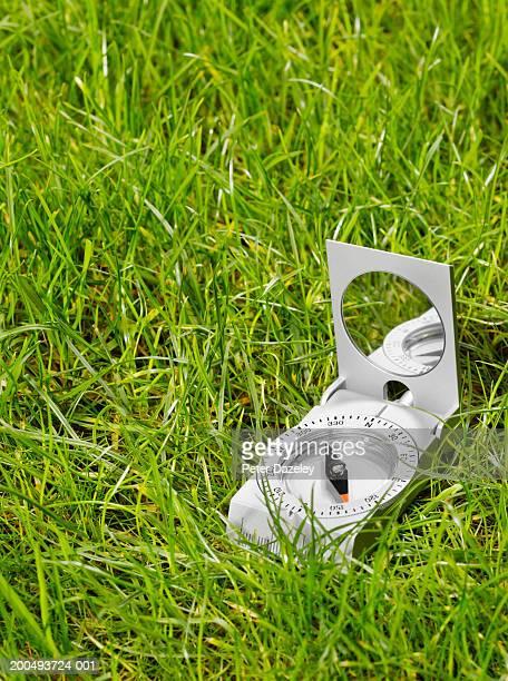 Compass on grass, close-up