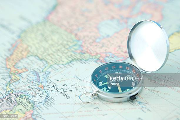Compass on world map