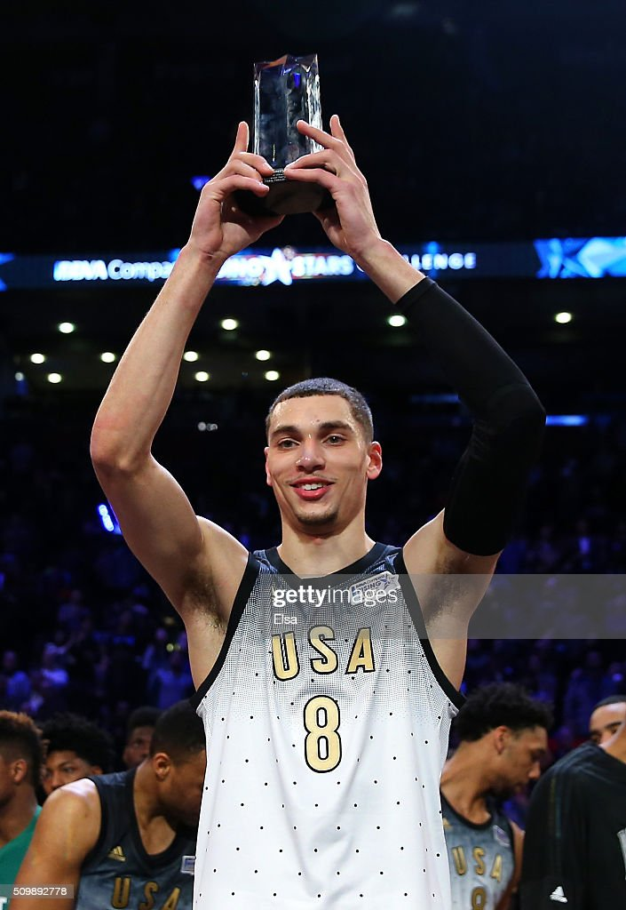 Compass Rising Stars Challenge MVP Zach LaVine of the Minnesota Timberwolves and the United States team holds up his trophy after defeating the World...