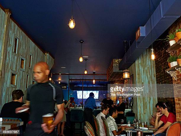 Compass Rose Bar Kitchen server J'on Alexander Desvine works dinner service on Friday May 16 2014